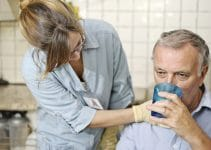 A man needs help drinking from a cup after a stroke that was possibly caused by medical malpractice.
