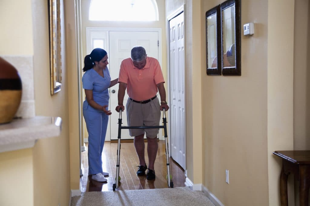 A home health aid helps a stroke patient in his home who was possibly a victim of malpractice.