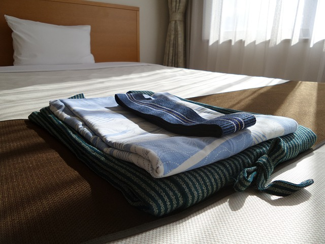 Empty bed with folded sheets at home waiting for stroke patient to return from hospital.